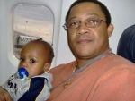 Tre' (Robert Bryant, III) and grandson - Robert IV on plane to Nashville